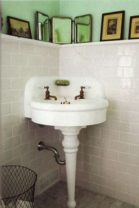 corner sink and shelf in bathroom