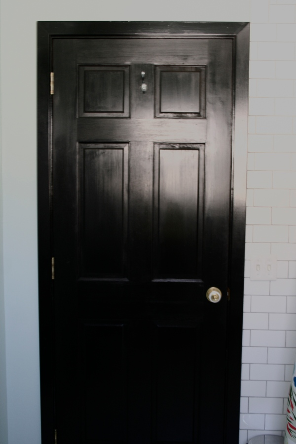 glossy black bathroom door