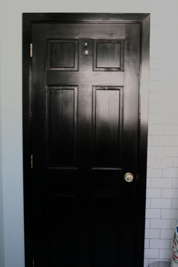 glossy black bathroom door